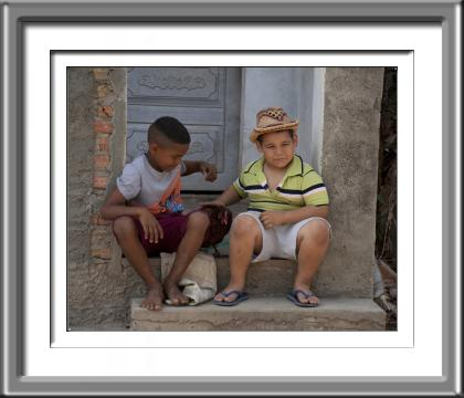 Cuba, children, boys, chicken, hen